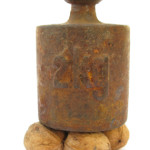 PRESSURE:  A Large 2KG Weight on Top of Walnuts  iStock_000007713684XSmall
